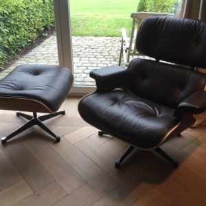 Eames chair with ottoman in dark brown leather and rosewood